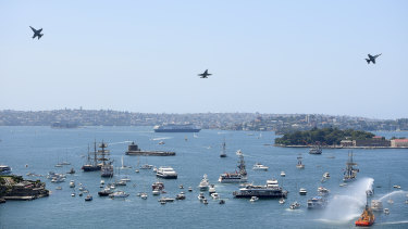 Aircraft conduct a flypast over Sydney Harbour during Australia Day 2019.