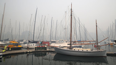Smoke on the water: Thick haze hangs over the dock at the Cruising Yacht Club of Australia after the cancellation of the Big Boat Challenge.