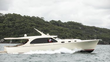 Matt Allen, owner of IchiBan, on his power boat in Sydney Harbour. The Sydney to Hobart yacht race was cancelled due to the Northern Beaches coronavirus cluster.
