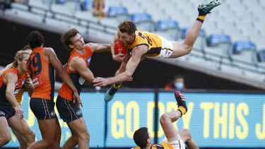 Hawthorn's Tim O'Brien lands after a spectacular mark at the MCG, the home of Australian sport.