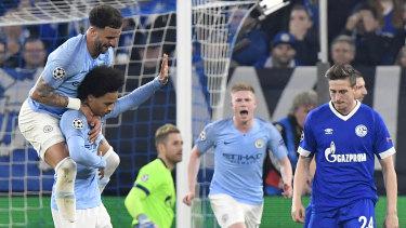 Leroy Sane (hand raised) celebrates his goal for Manchester City against Schalke 04.