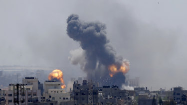 Smoke rises from an explosion caused by an Israeli airstrike in Gaza City.