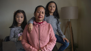 Sabita Shrestha with her grandchildren Ira, 4, and Eva, 7, at their Merrylands home.