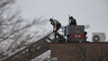 Police work on the scene outside of a King Soopers grocery store where a shooting took place in Boulder, Colorado.