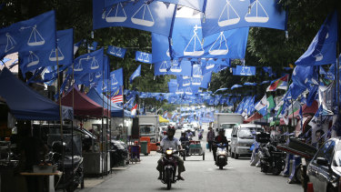Flags from different political parties hang along a street in Kuala Lumpur.