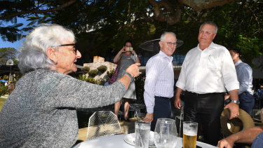 Prime Minister Malcolm Turnbull and LNP candidate for Longman, Trevor Ruthenberg, cop some advice from local Toni Lea while out campaigning on Friday.