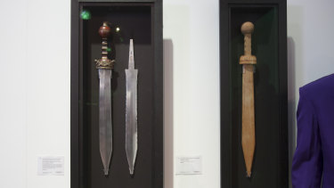 Russell Crowe's aluminium prop sword, spare blade and wooden training sword from the film <em>Gladiator</em>.