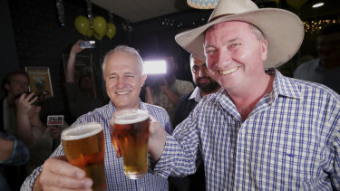 Prime Minister Malcolm Turnbull and New England candidate Barnaby Joyce celebrate at Barnaby Joyce's election night party at the Southgate Inn in Tamworth during the New England by-election on Saturday 2 December 2017.