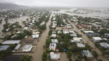 Houses are inundated in Townsville on Monday.