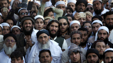 Mourners attend the funeral prayer of prominent Pakistani cleric Maulana Samiul Haq in Akora Khattak.