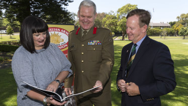 President of Australian Army Rugby Union Brigadier Ben James and Rugby Australia chief executive Raelene Castle chat with former Wallaby Bob Brown at Victoria Barracks in Sydney.