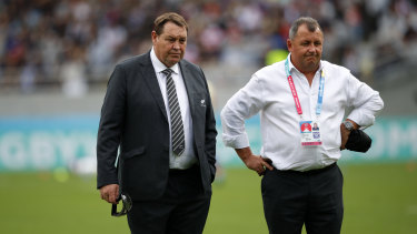 Passing the baton: Steve Hansen with Ian Foster during the World Cup in Japan.