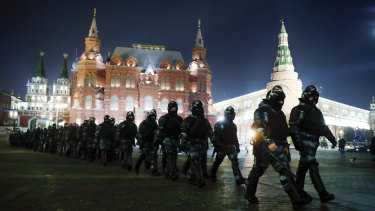 Servicemen of the Russian National Guard gather at the Red Square to prevent a protest rally in Moscow, Russia.