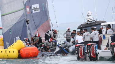 American Magic crew try to stop the boat sinking after it capsized in race two against Prada Luna Rosa 1during the 2021 PRADA Cup Round Robins on Auckland Harbour on January 17, 2021 in Auckland, New Zealand.