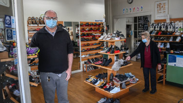 Joe and Norma Watt of Watt's Shoe Store on Lygon Street preparing to open from Wednesday. The business has been in the family for four generations.