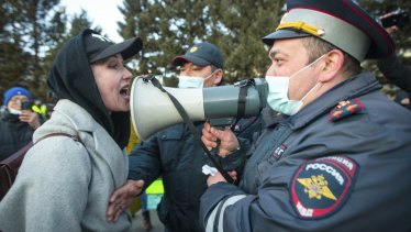 A woman argues with police officer during a protest in support of jailed opposition leader Alexei Navalny in Ulan-Ude, the regional capital of Buryatia, a region near the Russia-Mongolia border.