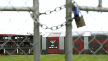 Lockout: Gates shut at Essendon's AFL headquarters after the positive COVID-19 test registered by their Irish import Conor McKenna.