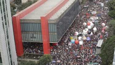 Demonstrators, many displaying the red colour of the opposition Labour Party, gather on Paulista Avenue in Sao Paulo to protest a massive cut in the education budget imposed by President Jair Bolsonaro.