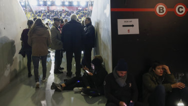 Basketball supporters wait to leave after a match at the Rhenus Sport stadium in Strasbourg, eastern France, as the shooting unfolds.
