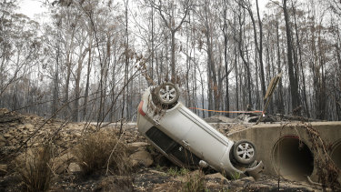 An overturned car in Nymboida which was ravaged by fires last week.