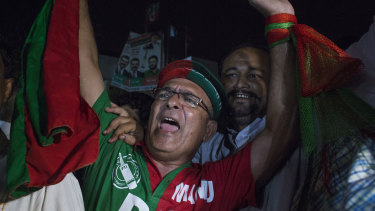 Supporters of Imran Khan, head of the Pakistan Tehreek-e-Insaf (PTI), also known as Movement for Justice, celebrate.