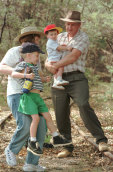 Tim Fischer with his wife Judy Brewer and sons Harrison and Dominic on the old Wagga to Tumbarumba railway line, 1998.