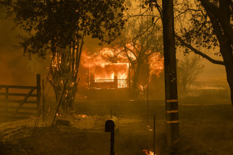A home burns along Cherry Glen Road during the LNU Lightning Complex fire in Vacaville, California. More than 100,000 people have been evacuated from the area.