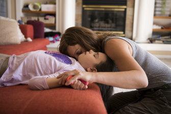 Julia Vitarello with her daughter Mila, 8, who has a rare neurological disorder.