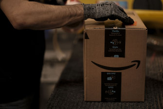 Warehouse workers get a pay bump as Amazon struggles to find enough staff to handle the pandemic-fuelled boom in orders.
