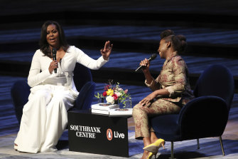 Michelle Obama, left, in conversation with writer Chimamanda Ngozi Adichie at the Royal Festival Hall in 2018.