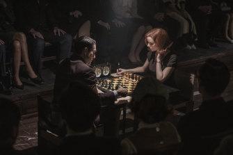 Marcin Dorocinski as Vasily Borgov and Anya Taylor-Joy as Beth Harmon in The Queen's Gambit.