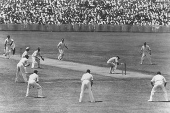 W. M. Woodfull of Australia ducks to avoid a rising ball from Harold Larwood of England.
