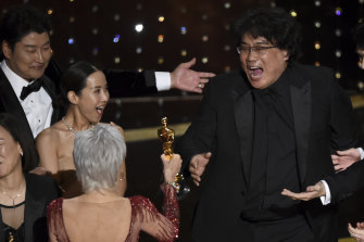 Excitement as Bong Joon-ho, right, wins best picture at the Academy Awards for Parasite last year.