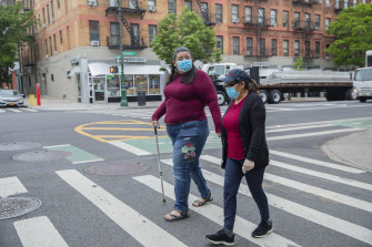 Janet Mendez (left) who spent almost three weeks in hospital with COVID-19, walks with her mother Maria in New York.