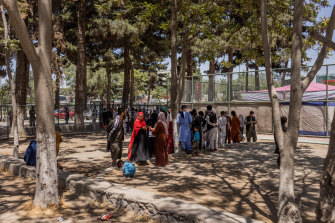 Families gathered in a small park in Kabul after fleeing Kunduz.