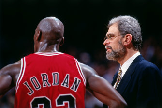 Coach Phil Jackson talks to Jordan in 1996.