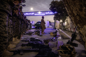 Members of the Badri 313 Battalion, a group of Taliban special forces fighters, tasked with securing Hamid Karzai International Airport and the surrounding area, pray on Saturday.