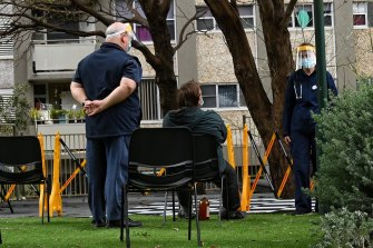 Health authorities set up a COVID-19 testing clinic outside the Redfern towers.