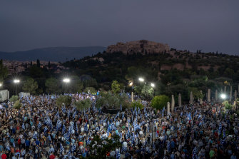 The Acropolis is seen in the distance during a pre-election rally for Kyriakos Mitsotakis.