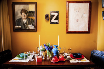 The dining room once shared by David McDermott and Peter McGough features a portrait of McDermott, left, and a drawing of McGough by his ex-lover.
