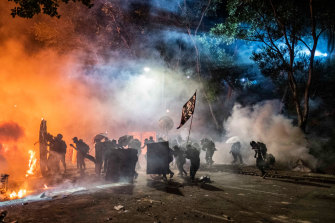 Protesters and riot police clash at the Chinese University of Hong Kong on November 12.