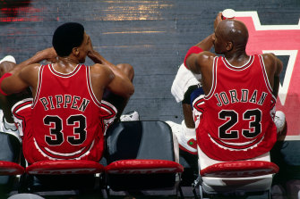 Scottie Pippen and Michael Jordan of the Chicago Bulls sit on the bench during a game in January 1998.