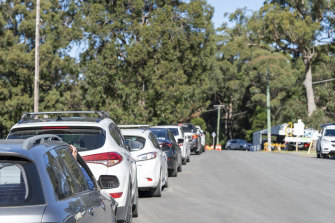 People line up for drive through testing in Huskisson on the NSW South Coast on Wednesday.