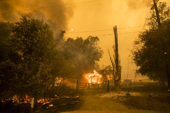 A home burns along Cherry Glen Road in Vacaville on Wednesday.