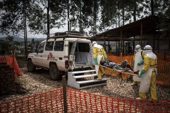 Health workers at an Ebola treatment centre in Butembo during an earlier outbreak in November 2018.