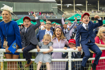 Cathy McEvoy, wife of the winning jockey, and her children cheer on Kerrin McEvoy during The Everest at Royal Randwick Racecourse in 2020.