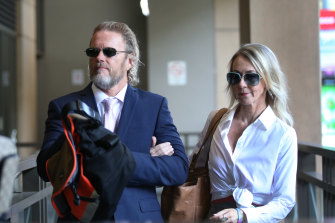 Craig McLachlan and his partner Vanessa Scammell arrive at court on Wednesday.