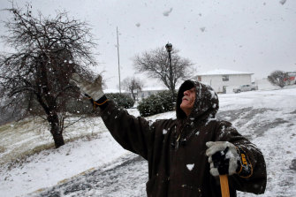 William Butricks welcomes the snow in his area as a sign a huge multi-day rainstorm has moved away.