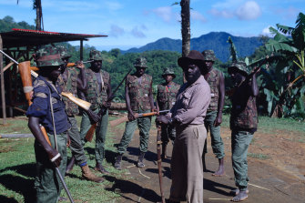 BRA leader Francis Ona with his men in his home village of Guava, above the Panguna mine, in 1994.