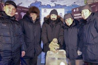 From left: Yakov Androsov, Albert Protopopov, Gennady Boyeskorov, Valery Plotnikov and Stanislav Kolesov from the Russian Academy of Sciences of the Republic of Sakha show off the body of a cave lion at the Kingdom of Permafrost museum in Yakutsk in 2015.